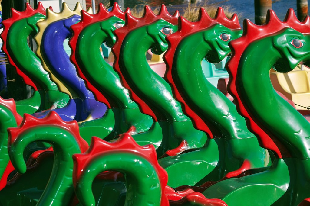 Stock Photo: 1566-918271 A closeup of sea serpent peddle boats moored at the Inner Harbor, Baltimore, Maryland