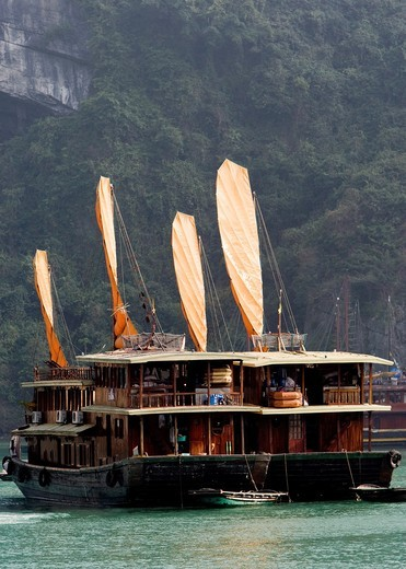 Stock Photo: 1566-920569 Tourist cruising junks Halong Bay Vietnam