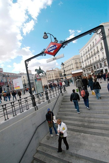 Puerta del Sol Spanish for ´Gate of the Sun´ is one of the most well known and busiest places in Madrid  This is the centre Km 0 of the radial network of Spanish roads  The square also contains the famous clock whose bells mark the traditional eating of t. Puerta del Sol Spanish for ´Gate of the Sun´ is one of the most well known and busiest places in Madrid  This is the centre Km 0 of the radial network of Spanish roads  The square also contains the famous clock whose bells mark the traditional : Stock Photo
