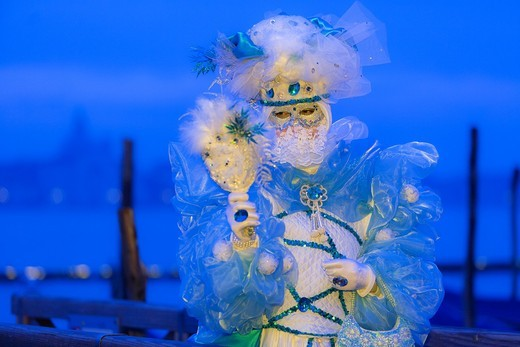 Stock Photo: 1566-921110 A masked woman looking in her mirror at the carnival in Venice, Italy, Europe