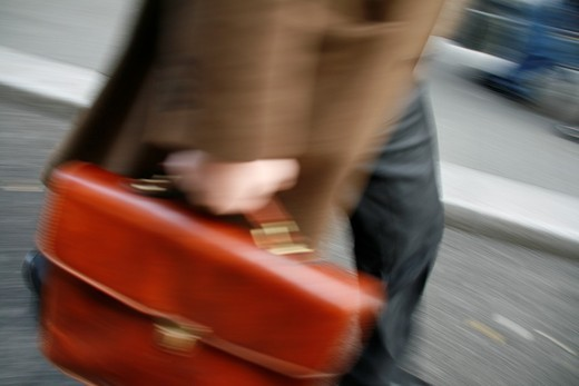 commuter with briefcase in town : Stock Photo