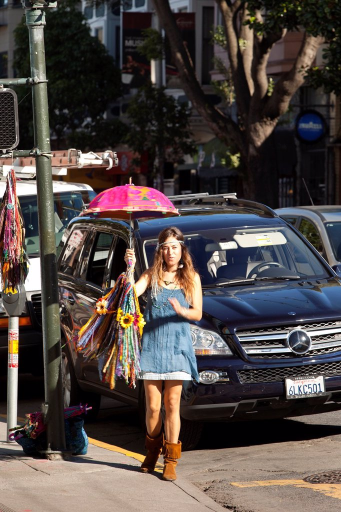 Young woman selling beads in the hippie neighborhood of Haight Ashbury, San Francisco, California, USA : Stock Photo
