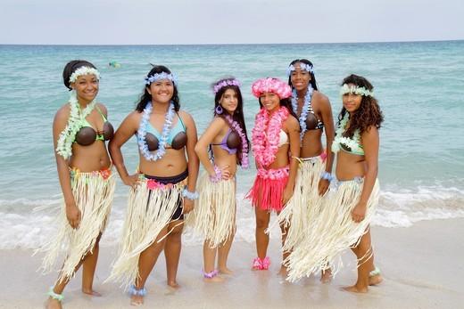 Florida, Miami Beach, North Beach, Atlantic Ocean, shore, luau party, lei, Hispanic, Black, girl, teen, straw skirt, : Stock Photo