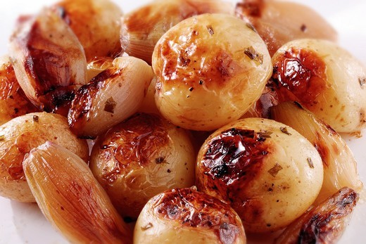 Roast potatoes in their skins and onions food photos : Stock Photo