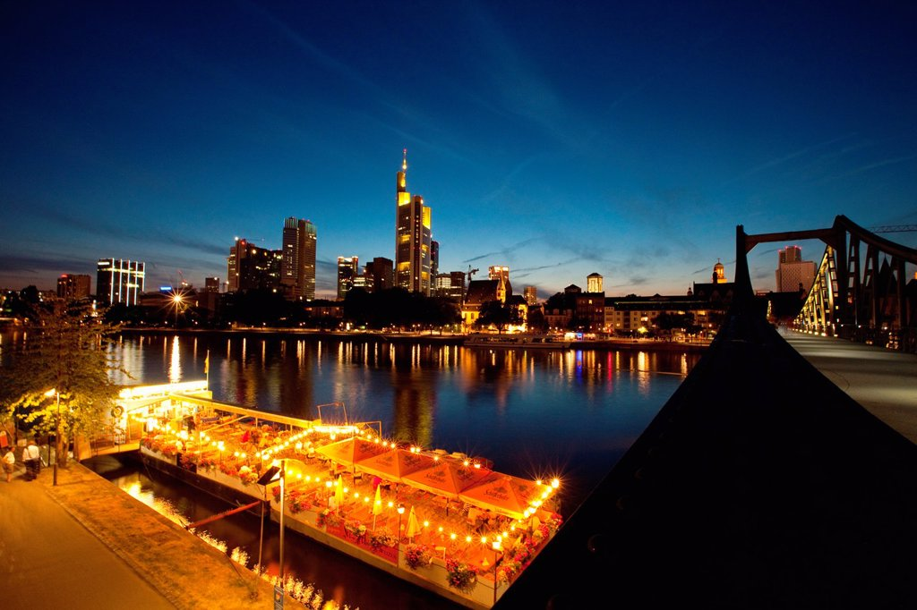 Stock Photo: 1566-923490 The Frankfurt am Main skyline and boat restaurants moored on the Main river, seen from Alte brücke bridge at sunset, Germany, Europe