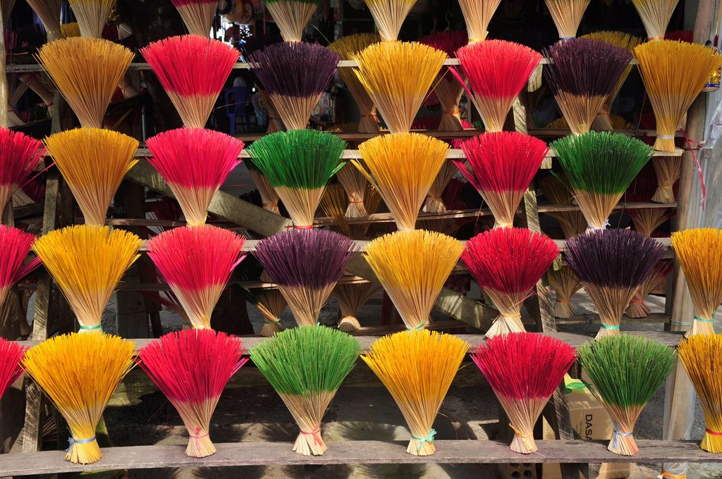 Stock Photo: 1566-923966 Asia,South East Asia,Vietnam,Rows of colorful incense sticks lined up in a roadside stall near Hue