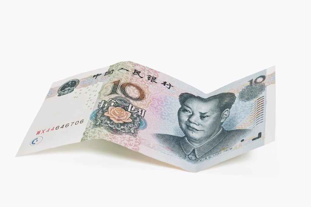 Stock Photo: 1566-924555 10 yuan bill with the portrait of Mao Zedong The renminbi, the Chinese currency, was introduced in 1949 after the founding of the People´s Republic of China China, Asia