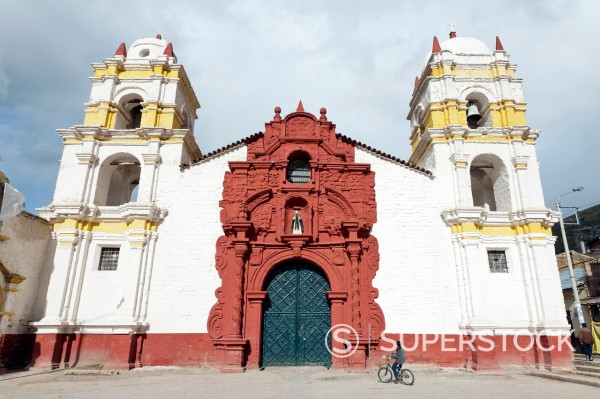 Stock Photo: 1566-924580 Boy on a bicycle in front of Igleisia Santo Domingo church in Huancavelica, Peru