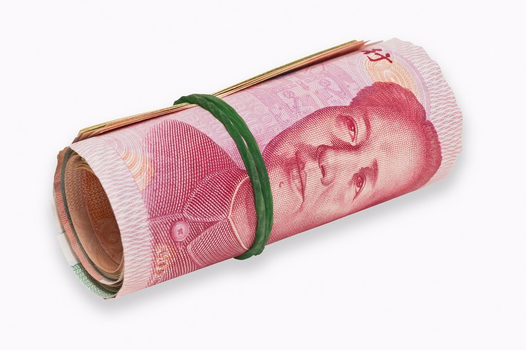 Many 100 Yuan bills, rolled up and held together with a rubber The renminbi, the Chinese currency, was introduced in 1949 after the founding of the People´s Republic of China China, Asia : Stock Photo