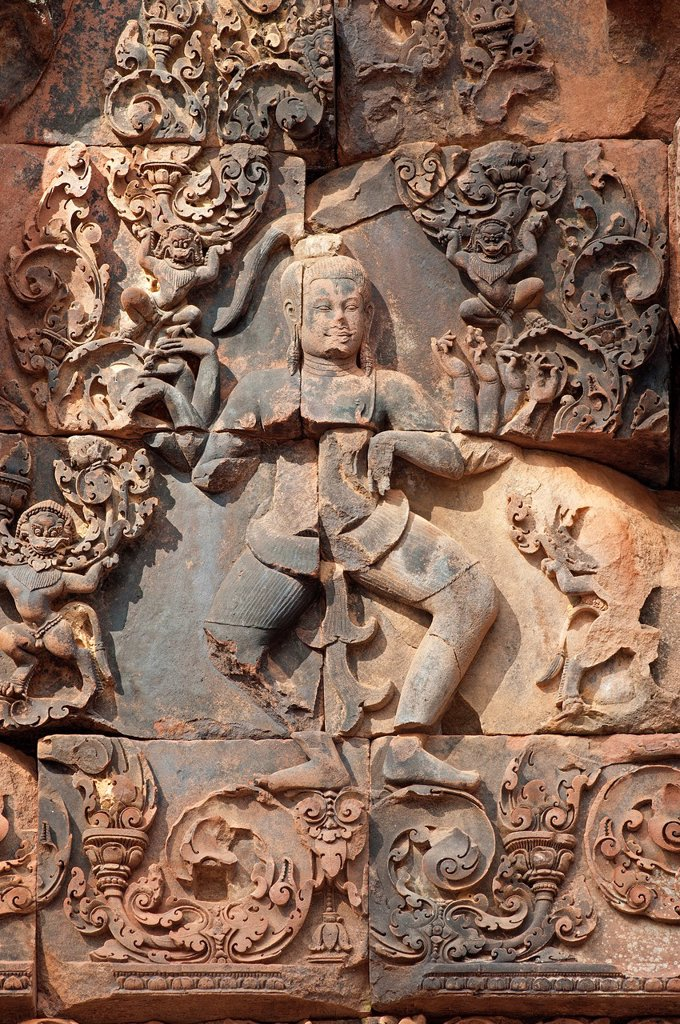 Stock Photo: 1566-925542 God Shiva with multiple arms depicted on the eastern gopura of the inner enclosure wall, Banteay Srei temple, Citadel of the Women, Angkor, Cambodia