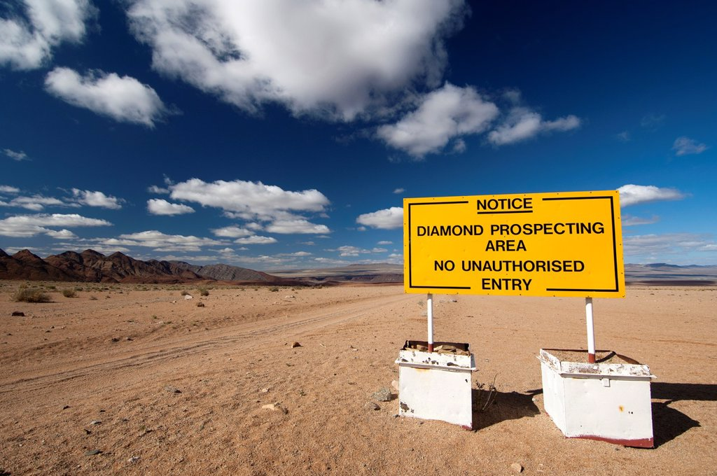 Prohibition sign at the entrance to a diamond prospecting area in the border region between South Africa and Nambia behind, Richtersveld National Park, Northern Cape Province, South Africa : Stock Photo