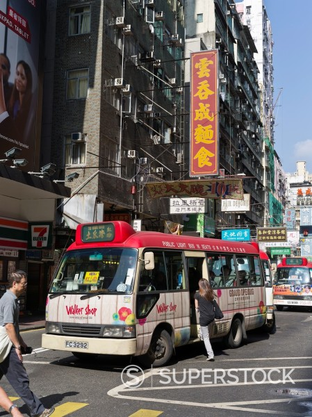 Stock Photo: 1566-926291 MONGKOK HONG KONG Passenger boarding Red Public light bus RMB minibus city street