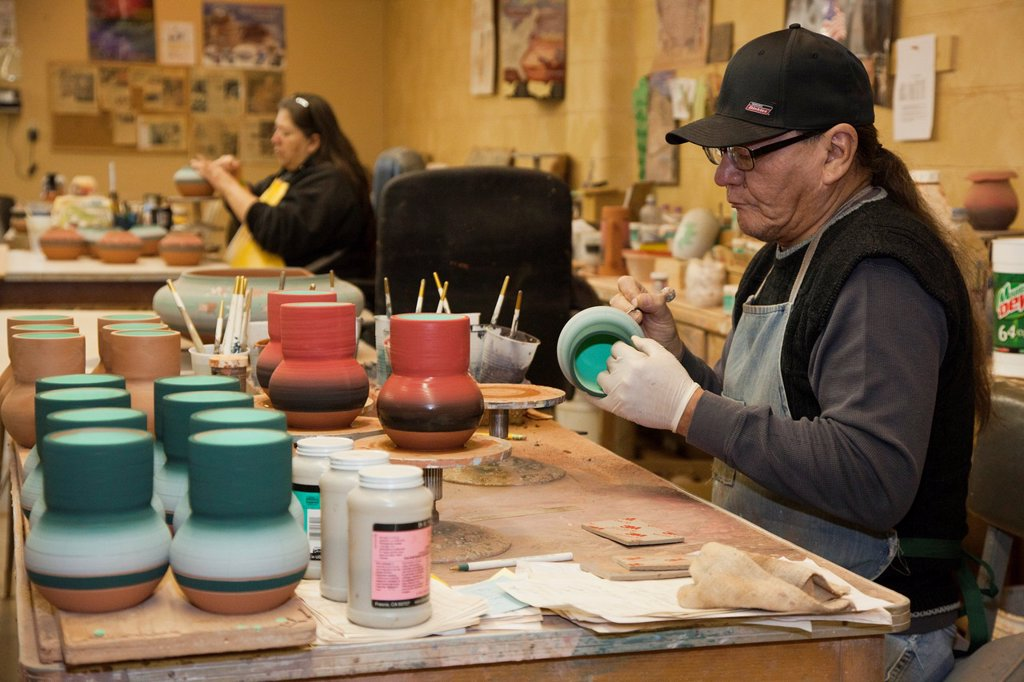 Stock Photo: 1566-926737 Rapid City, South Dakota - Del Loefer, a member of the Rosebud Sioux, creates pottery at Sioux Pottery