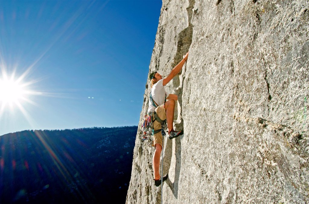 Nic Houser rock climbing a route called Corrugation Corner which is rated 5,7 and located at Lovers Leap near Lake Tahoe in northern California : Stock Photo