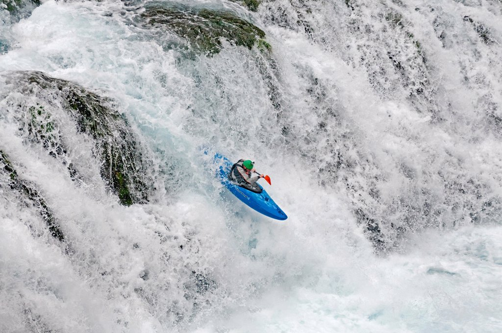 Stock Photo: 1566-927568 Kyle Keegan kayaking the falls in Box Canyon which are rated Class 5 at Box Canyon State Park in southern Idaho