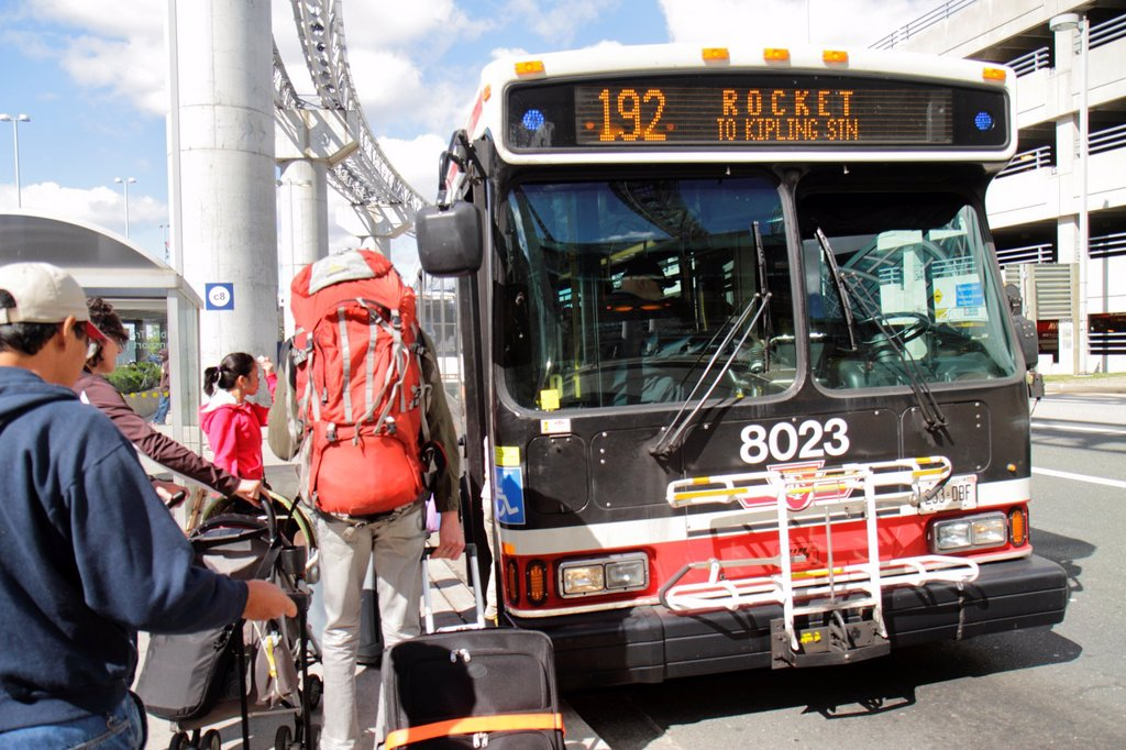 Canada, Ontario, Toronto, Lester B  Pearson International Airport, YYZ, TTC, public bus, transportation, mass transit, stop, Asian, woman, man, backpack, passenger, boarding, 192, : Stock Photo