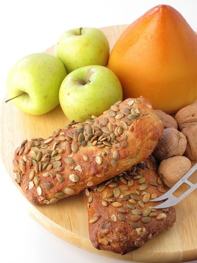 Smoked cheese, apple, seeds bread and walnuts : Stock Photo