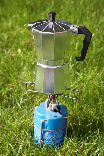gourmet coffee percolator precariously balanced on a gas camping stove : Stock Photo