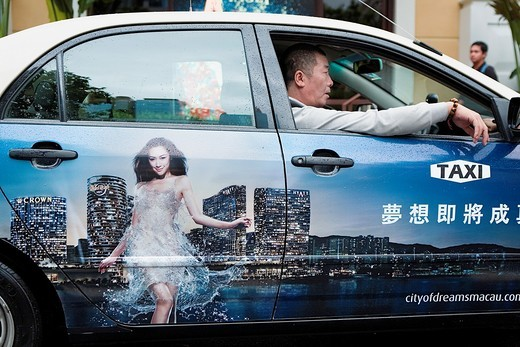 Stock Photo: 1566-930359 Taxi With advertisement of city of dreams,Macau,China