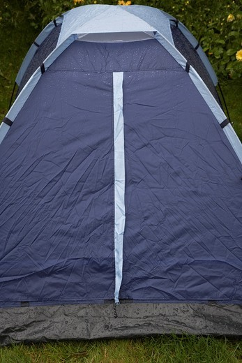 heavy rain falling on a small pitched dome tent : Stock Photo
