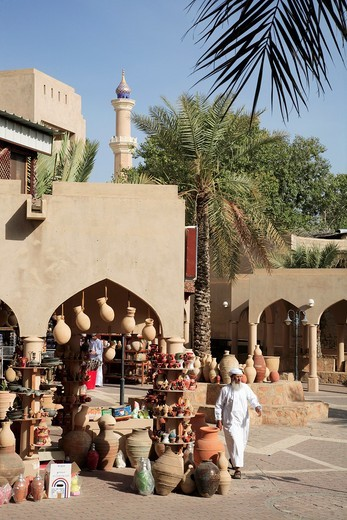 Oman, Al-Dakhiliyah, Nizwa, souq, pottery shop, street scene : Stock Photo