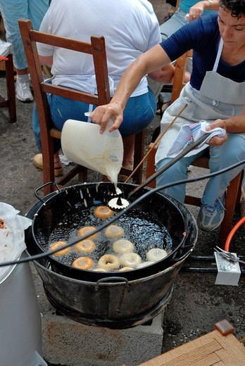 Stock Photo: 1566-935552 Woman cooking Spanish bunuelos at Balearic Culture day in Santa Eulalia, Ibiza, Spain