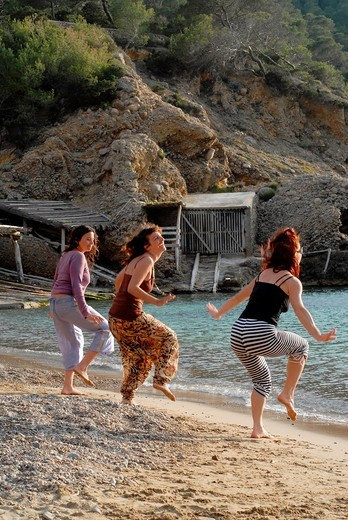 People enjoying sundays in popular Benirras beach, where drum players play until sunset, Ibiza, Spain : Stock Photo