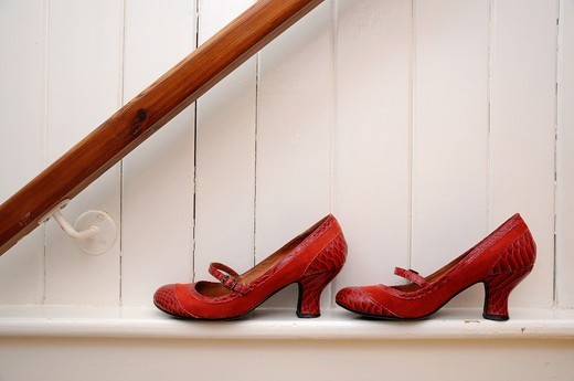 Red shoes on white wall : Stock Photo