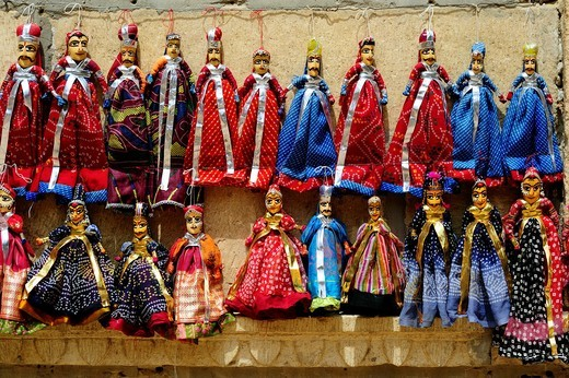 Stock Photo: 1566-936483 Coloured puppets for sale in the streets of Jaisalmer, Rajasthan, India.