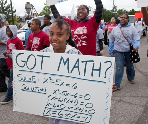 Detroit, Michigan - High school students in the Wayne State University Math Corps program march in the Labor Day parade : Stock Photo
