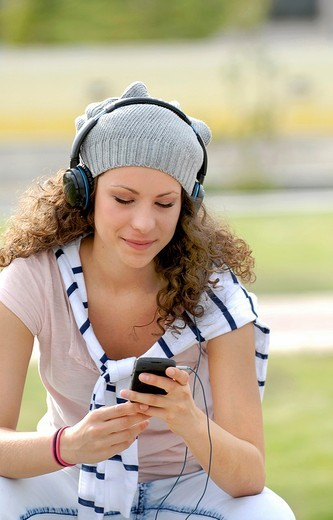Cute young woman listening music with headphones : Stock Photo