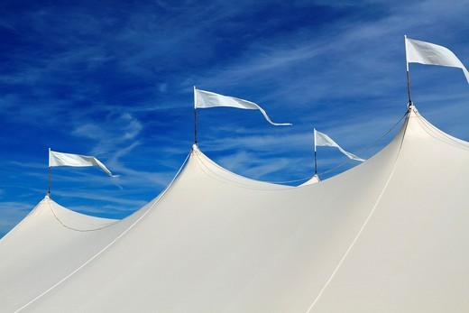 The top of a large white event tent in front of a blue sky  On the beach in Long Branch, New Jersey, USA : Stock Photo
