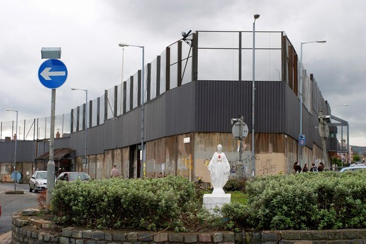 statue of our lady on roundabout in front of former ruc and psni police station in andersonstown west belfast northern ireland : Stock Photo