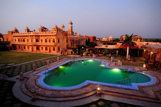 Stock Photo: 1566-941708 Khimsar Fort 15th century building and its green water pool at sunset  Rajasthan, India
