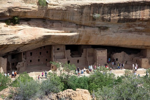 Cortez, Colorado - Visitors tour the Spruce Tree House cliff dwelling at Mesa Verde National Park  The park features cliff dwellings of ancestral Puebloans that are nearly a thousand years old : Stock Photo
