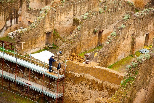 A lone worker helping to restore the ruins of Herculaneum, Campania, Italy : Stock Photo