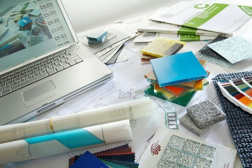 A desk full of swatches, samples and planning designs : Stock Photo