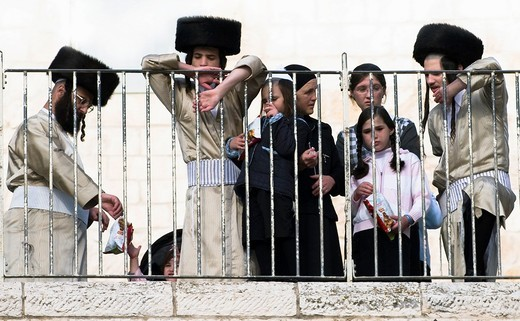 Stock Photo: 1566-948625 An Orthodox Jewish family visits the Wailing wall in the old city of Jerusalem during the Passover pilgrimage.