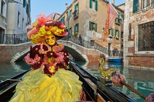 Stock Photo: 1566-948673 A masked woman in a gondola at the carnival in Venice, Italy, Europe