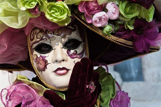 Portrait of a masked woman at the carnival in Venice, Italy, Europe : Stock Photo