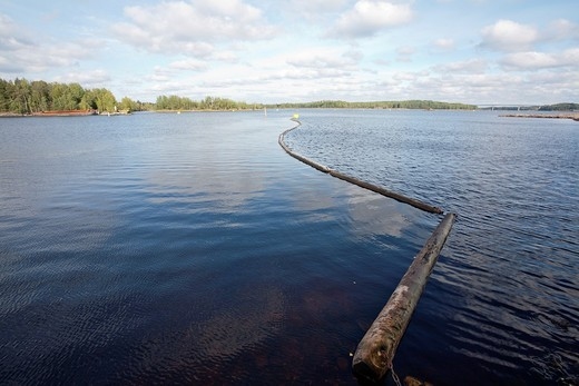 log boom barrier floating on water : Stock Photo