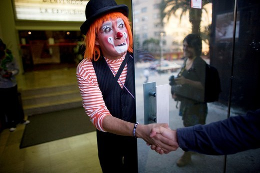 A clown shakes hands with a photographer during the 16th International Clown Convention: The Laughter Fair organized by the Latino Clown Brotherhood, in Mexico City, October 17, 2011 : Stock Photo