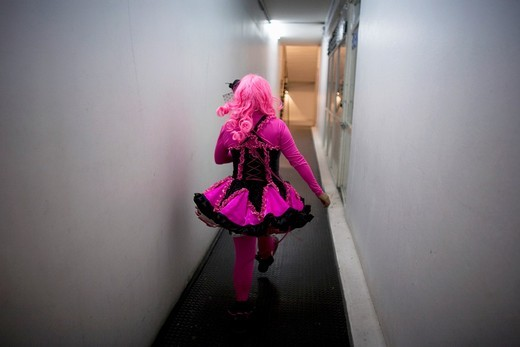 Stock Photo: 1566-949008 A female clown walks backstage at the 16th International Clown Convention: The Laughter Fair organized by the Latino Clown Broterhood, in Mexico City, October 17, 2011