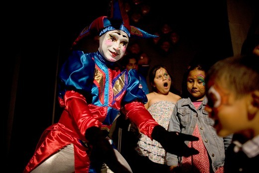 A buffon clown plays with children during the 16th International Clown Convention: The Laughter Fair organized by the Latino Clown Broterhood, in Mexico City, October 17, 2011 : Stock Photo