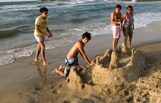Israeli teenagers playing on the beach in Tel Aviv. : Stock Photo