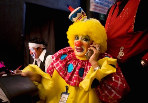 Stock Photo: 1566-949574 A clown speaks on a cellphone during the 16th International Clown Convention: The Laughter Fair organized by the Latino Clown Brotherhood, in Mexico City, October 17, 2011