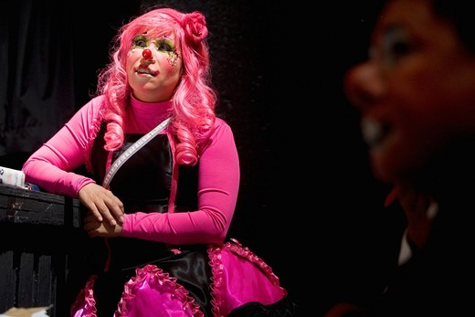 A female clown judges a show during a competition at the 16th International Clown Convention: The Laughter Fair organized by the Latino Clown Brotherhood, in Mexico City, October 17, 2011 : Stock Photo