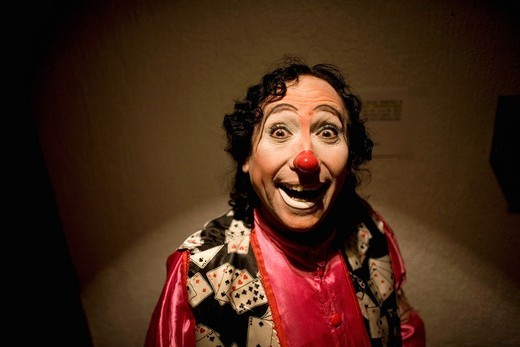A clown smiles as he posses for a picture at the 16th International Clown Convention: The Laughter Fair organized by the Latino Clown Brotherhood, in Mexico City, October 17, 2011 : Stock Photo