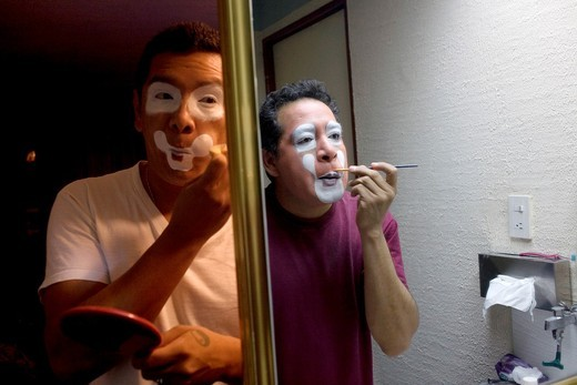 Clowns put on make-up in front of a mirror in their shared room during the 16th International Clown Convention: The Laughter Fair organized by the Latino Clown Brotherhood in Mexico City, October 17, 2011 : Stock Photo
