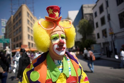Stock Photo: 1566-949586 A clown walks in a parade during the 16th International Clown Convention: The Laughter Fair organized by the Latino Clown Brotherhood, in Mexico City, October 17, 2011
